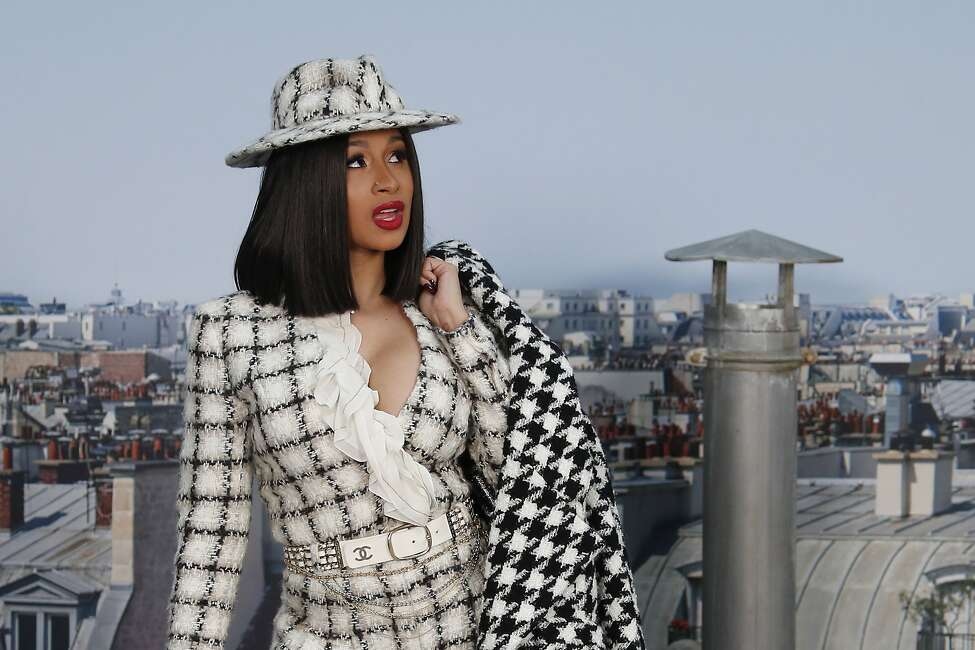 File - In this Tuesday, Oct. 1, 2019 file photo, Singer Cardi B poses for photographers as she arrives for the Chanel Ready To Wear Spring-Summer 2020 collection in Paris, France. Cardi B's latest announcement is that she wants to run for office. (AP Photo/Francois Mori, file)
