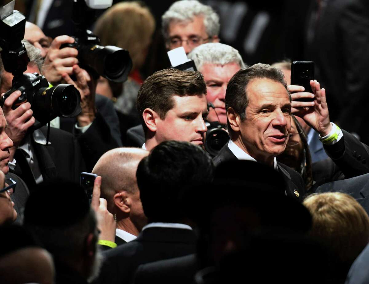 Gov. Andrew Cuomo is trailed by photographers as he meets with guests following his 2020 State of the State Address on Wednesday, Jan. 8, 2020, at Empire State Plaza Convention Center in Albany, N.Y. (Will Waldron/Times Union)