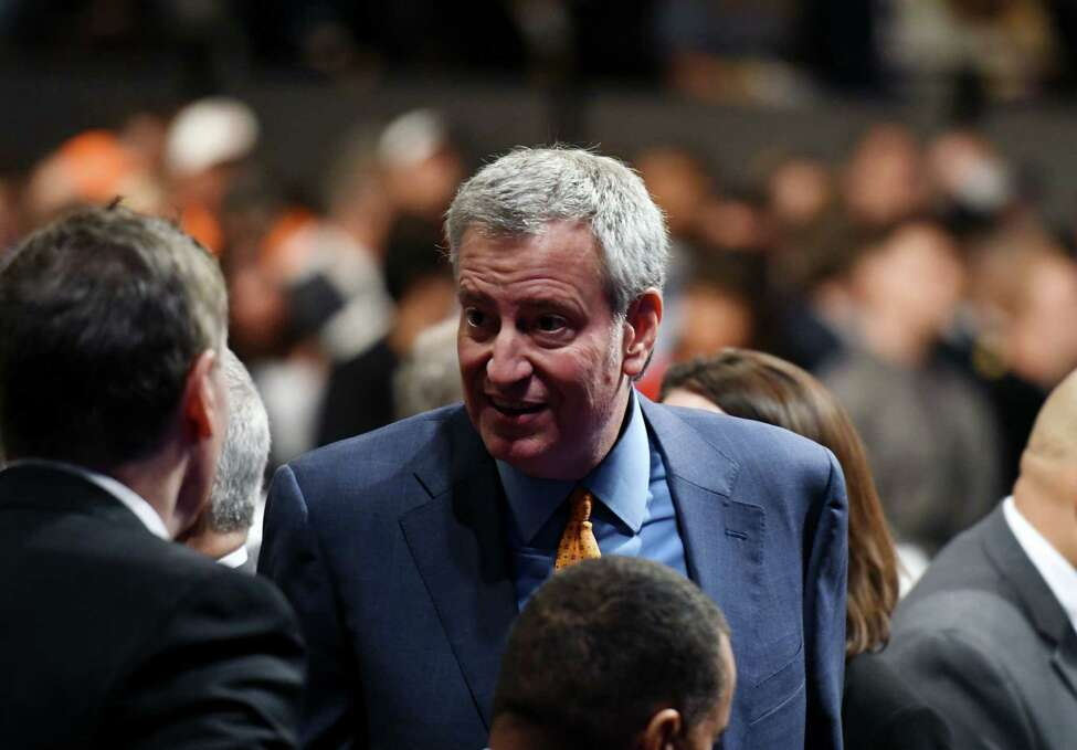 New York City Mayor Bill de Blasio meets with guests before the start of Gov. Andrew Cuomo's 2020 State of the State Address on Wednesday, Jan. 8, 2020, at Empire State Plaza Convention Center in Albany, N.Y. (Will Waldron/Times Union)