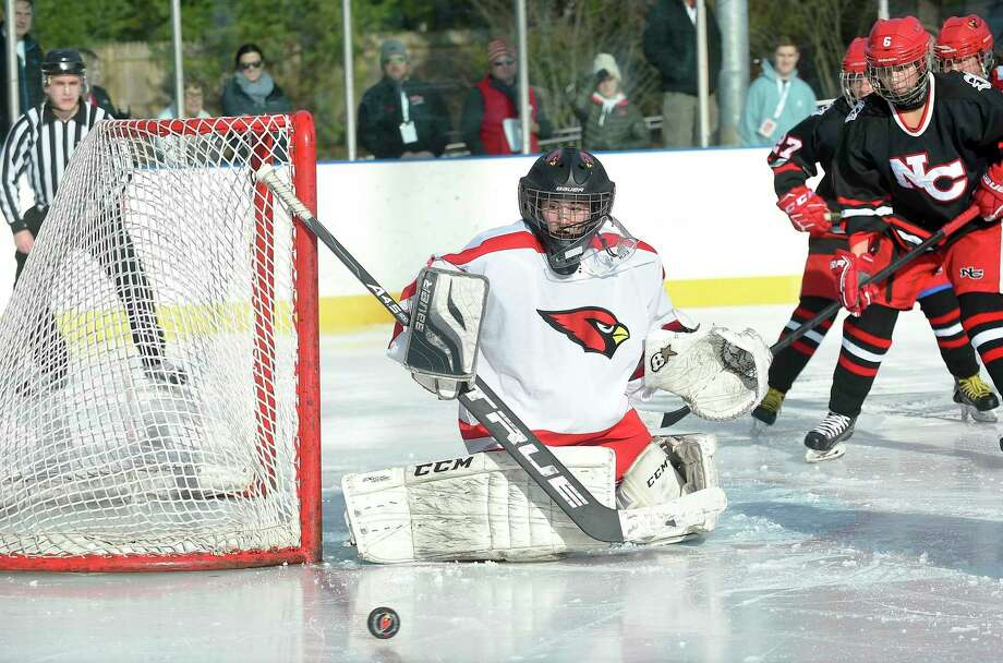 Greenwich goalie Jessica Ware defends the goal in the second period against New Canaan in the 3rd Winter Classic at the Greenwich Skating Club in December. Photo: Matthew Brown / Hearst Connecticut Media / Stamford Advocate