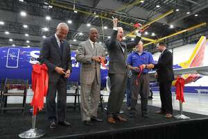 Houston Airport System Director Mario Diaz (l-r), Mayor Sylvester Turner and Southwest Airlines CEO Gary Kelly express their excitement during the Southwest Airlines opening of a $125 million maintenance hangar at Hobby Airport Wednesday, Jan. 8, 2020, in Houston.