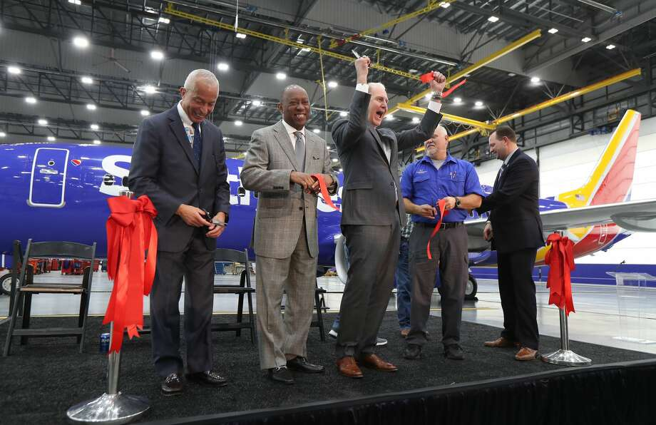 Houston Airport System Director Mario Diaz (l-r), Mayor Sylvester Turner and Southwest Airlines CEO Gary Kelly express their excitement during the Southwest Airlines opening of a $125 million maintenance hangar at Hobby Airport Wednesday, Jan. 8, 2020, in Houston. Photo: Steve Gonzales / © 2020 Houston Chronicle