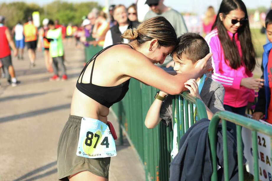 One of the more than 1,200 runners in last year's inaugural Pearland Half Marathon greets a fan. The event will occur this year in March from Independence Park. Photo: IRun Productions / IRun Productions