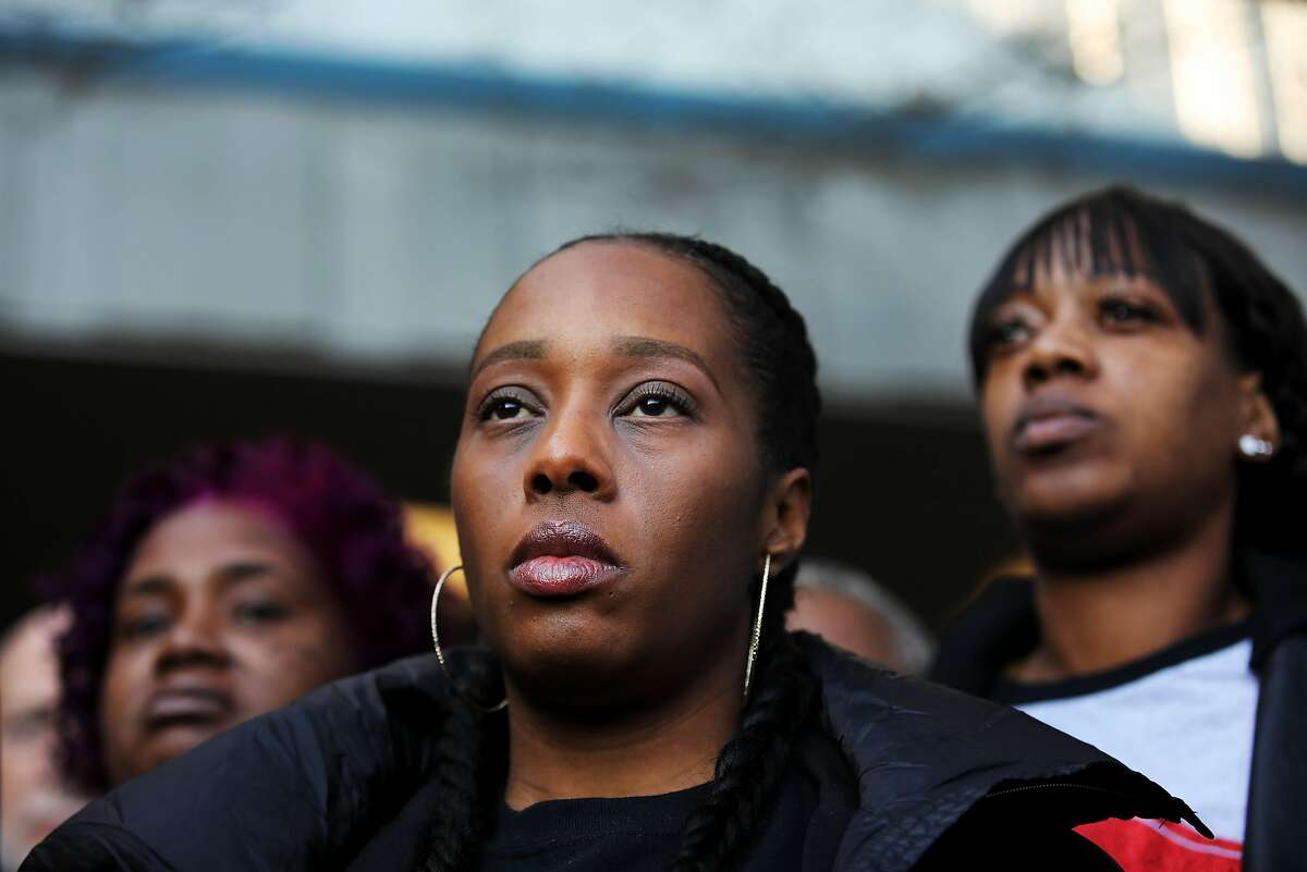 Sharena Thomas, back left, Dominique Walker, and Misty Cross, with Moms 4 Housing, stand together during a press conference outside the Hayward Hall of Justice in Hayward, Calif., on Monday, December 30, 2019. Judge Patrick McKinney declined to rule against Moms 4 Housing during an eviction hearing on Monday. Moms 4 Housing is a group of mothers who moved into a vacant house on Magnolia Street in West Oakland in November.