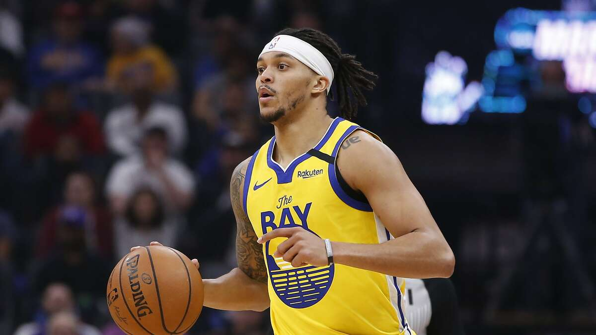 Golden State Warriors guard Damion Lee during the first quarter of an NBA basketball game against the Sacramento Kings in Sacramento, Calif., Monday, Jan. 6, 2020. The Kings won 111-98. (AP Photo/Rich Pedroncelli)