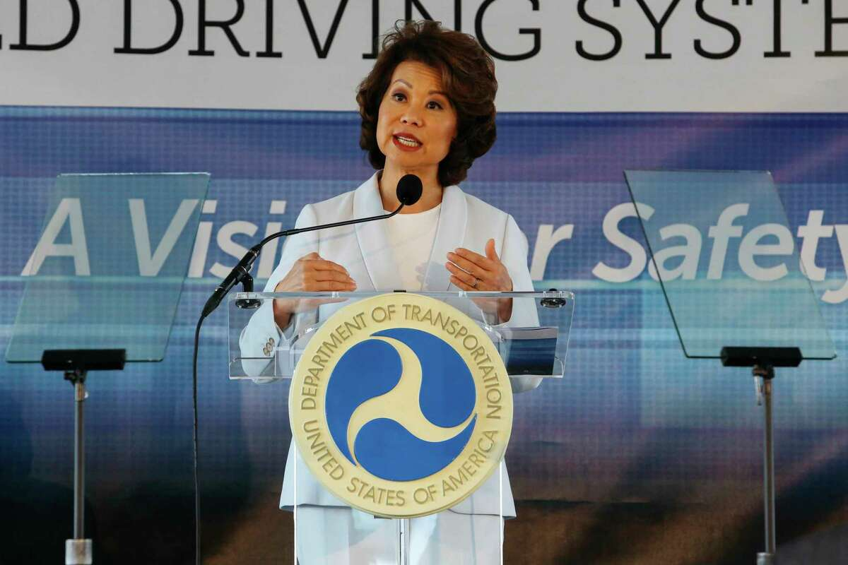 FILE - In this Sept. 12, 2017 file photo, U.S. Transportation Secretary Elaine Chao announces new voluntary safety guidelines for self-driving cars during a visit to an autonomous vehicle testing facility at the University of Michigan, in Ann Arbor, Mich. The Trump administration announced its most recent round of guidelines for autonomous vehicle makers, continuing to rely on the industry to police itself despite calls for specific regulations. Chao announced the proposed guidelines in a speech Wednesday, Jan. 8, 2020 at the CES gadget show in Las Vegas, saying in prepared remarks that a€œAV 4.0a€ will ensure U.S. leadership in developing new technologies.(Hunter Dyke/The Ann Arbor News via AP, File)