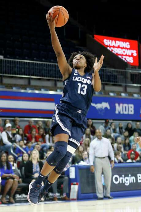 Connecticut guard Christyn Williams (13) scores against SMU during the first half of an NCAA college basketball game in University Park,Texas, Sunday, Jan. 5, 2020. (AP Photo/Michael Ainsworth) Photo: Michael Ainsworth / Associated Press / Copyright 2020 The Associated Press. All rights reserved.