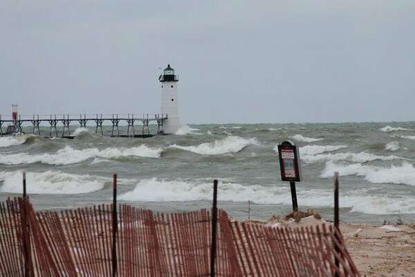 High winds on Wednesday continued to pummel the already vanishing Lake Michigan shoreline. Waves were seen going over the piers at both beaches on a regular basis. (Ken Grabowski/News Advocate)