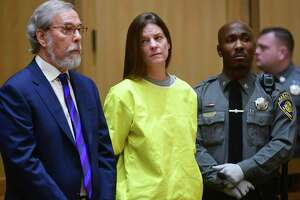Michelle Troconis, center, is arraigned on conspiracy to commit murder charges in Stamford Superior Court Wednesday, January 8, 2020, in Stamford, Conn.