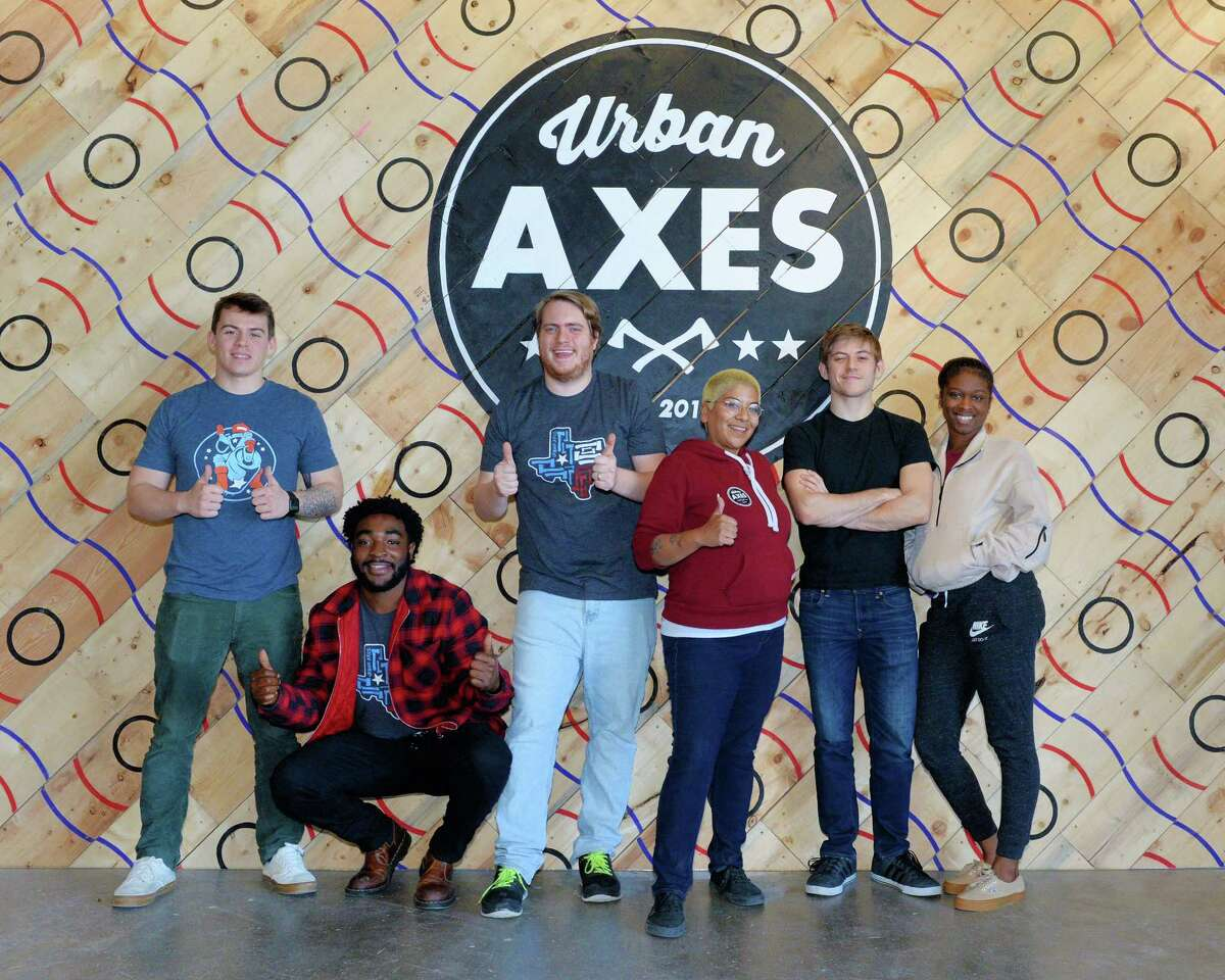 (L-R) Staffers Gary Innocenti, Christian Mawete, Kyle Hough, Jay Allen, Sam Kelly and Sidney Lyon pose at Urban Axes, Houston, TX on Saturday, January 4, 2020.