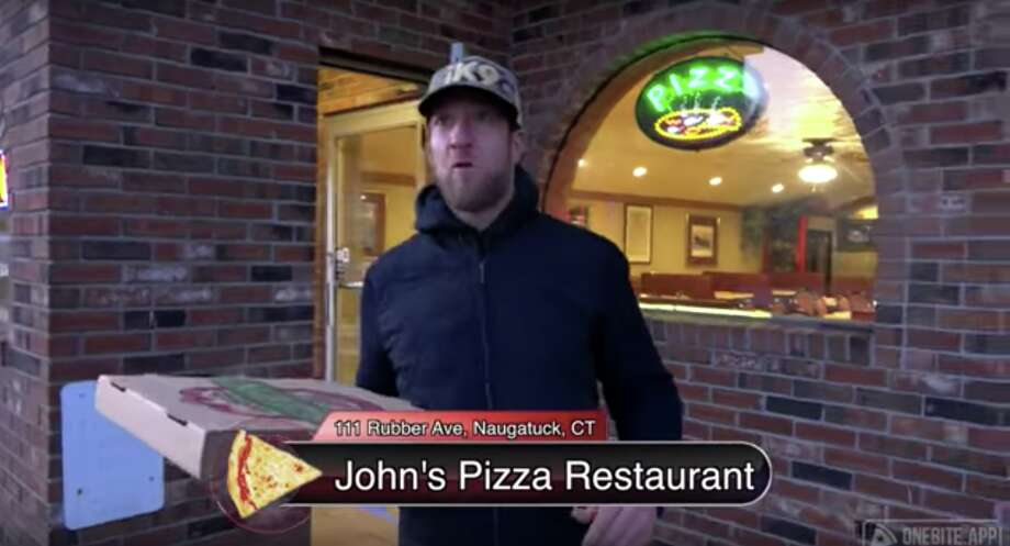 """David Portnoy, founder of Barstool Sports, visitedMike's Pizza Palace andJohn's Pizza Restaurant in Naugatuck last week as part of his """"One Bite with Davey Pageviews"""" series. Photo: Screenshot Via Barstool Sports"""