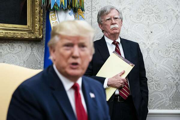 John Bolton listens to President Donald Trump in the White House in July 2019. MUST CREDIT: Washington Post photo by Jabin Botsford