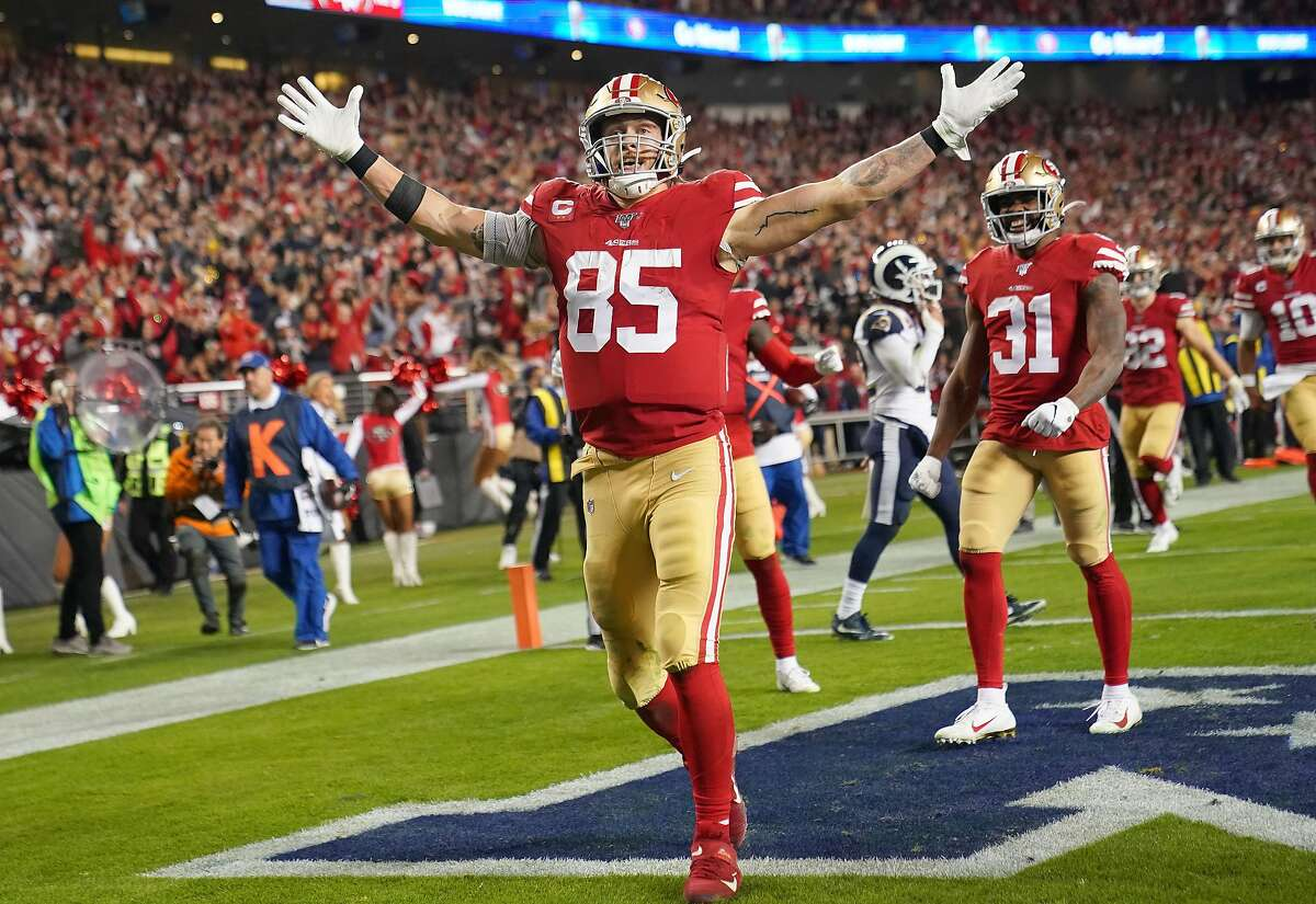 SANTA CLARA, CALIFORNIA - DECEMBER 21: George Kittle #85 of the San Francisco 49ers celebrates after catching a touchdown pass against the Los Angeles Rams during the second half of an NFL football game at Levi's Stadium on December 21, 2019 in Santa Clar