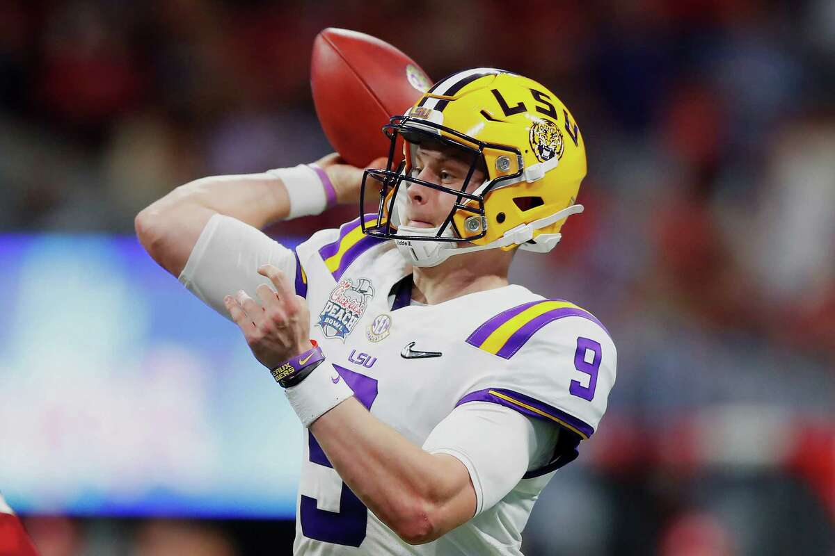 ATLANTA, GEORGIA - DECEMBER 28: Quarterback Joe Burrow #9 of the LSU Tigers delivers a pass over the defense of the Oklahoma Sooners during the Chick-fil-A Peach Bowl at Mercedes-Benz Stadium on December 28, 2019 in Atlanta, Georgia. (Photo by Todd Kirkland/Getty Images)