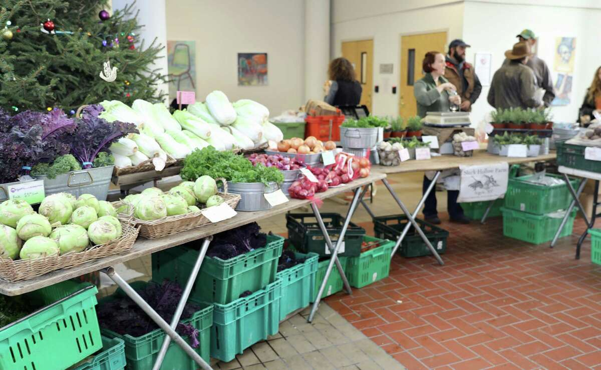 Shopping at the Troy farmers market at the Atrium. (Photo by Duncan Crary for the Troy Waterfront Farmers Market.)