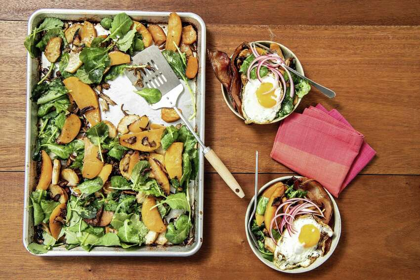 Hearty rutabaga and mushroom hash, basted in bacon fat and served with fried eggs, the perfect in-between-holidays breakfast for a crowd. Prop styling by Nidia Cueva. (Mariah Tauger/Los Angeles Times/TNS)