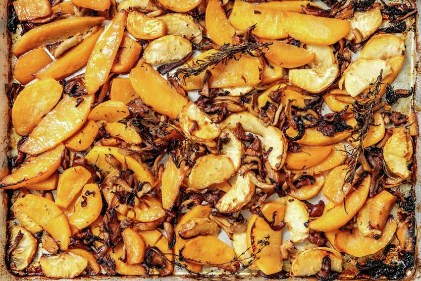 A sheet pan of roasted rutabaga, celery root and mushrooms basted in bacon fat. Prop styling by Nidia Cueva. (Mariah Tauger/Los Angeles Times/TNS)
