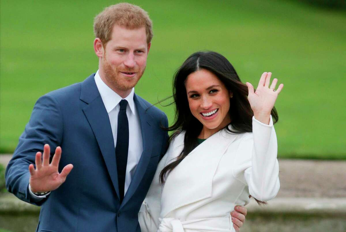 (FILES) In this file photo taken on November 27, 2017 Britain's Prince Harry and his fiancA©e US actress Meghan Markle pose for a photograph in the Sunken Garden at Kensington Palace in west London, following the announcement of their engagement. - Britain's Prince Harry and his wife Meghan will step back as senior members of the royal family and spend more time in North America, the couple said in a historic statement Wednesday. (Photo by Daniel LEAL-OLIVAS / AFP) (Photo by DANIEL LEAL-OLIVAS/AFP via Getty Images)