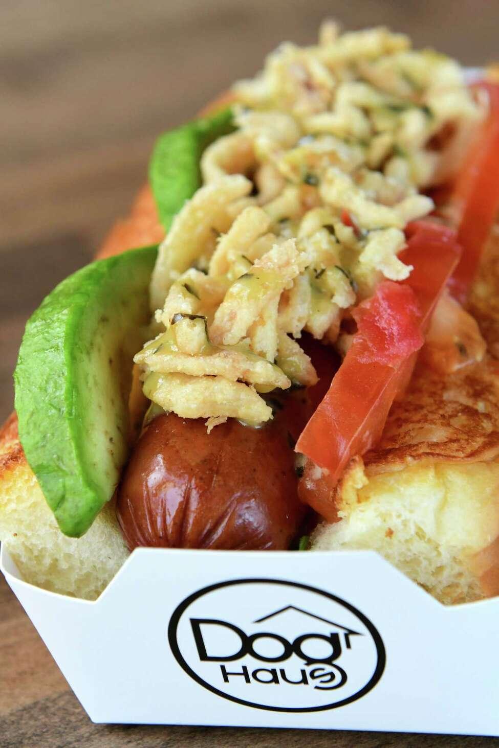 Sooo cali haus dog - wild arugula, avocado, tomato, crispy onions, spicy basil aioli at Dog Haus Biergarten on Wednesday, June 12, 2019 in Clifton Park, N.Y. (Lori Van Buren/Times Union)