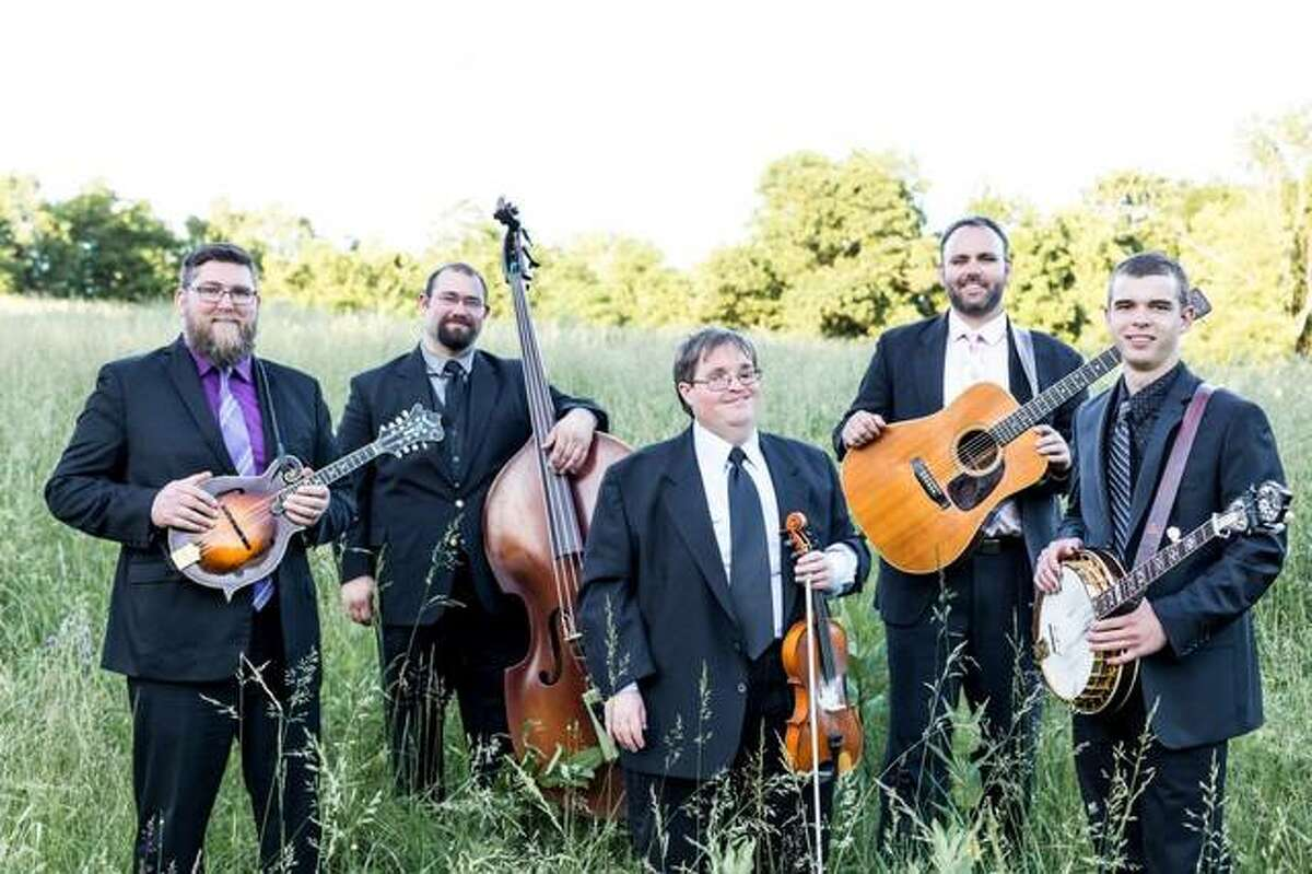 """Michael Cleveland, center, nominated by Grammy voters for his album """"Tall Fiddler,"""" flanked by group Flamekeeper, whose four members, pictured, play on the album. """"Tall Fiddler"""" is among Grammy nominees for Best Bluegrass Album."""