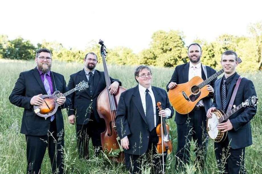 "Michael Cleveland, center, nominated by Grammy voters for his album ""Tall Fiddler,"" flanked by group Flamekeeper, whose four members, pictured, play on the album. ""Tall Fiddler"" is among Grammy nominees for Best Bluegrass Album. Photo: For The Telegraph"