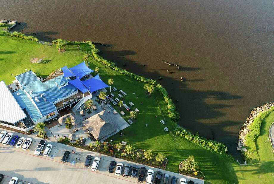 An aerial photo of Neches River near the Neches River Wheelhouse Wednesday evening. Port Neches will be working on its riverfront to prevent erosion by installing a bulkhead near the restaurant.  Photo taken on Wednesday, 07/24/19. Ryan Welch/The Enterprise Photo: Drone Image: Ryan Welch / Enterprise File Drone Image / ©Ryan Welch