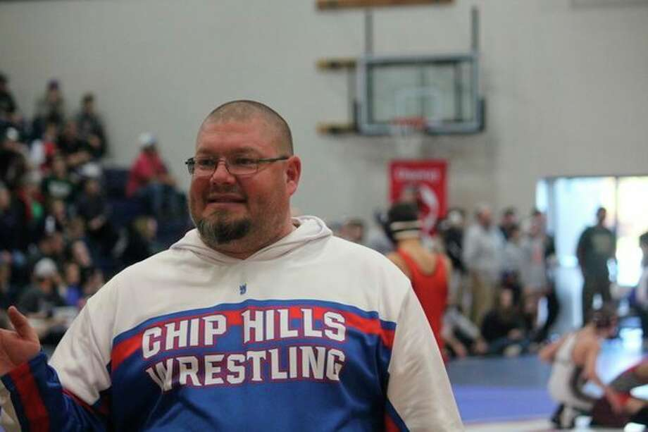 Chippewa Hills coach Kevin Edwards watched his team take two wrestling wins on Wednesday. (Pioneer photo/John Raffel)