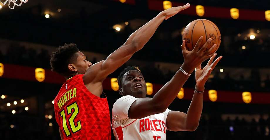 ATLANTA, GEORGIA - JANUARY 08: Clint Capela #15 of the Houston Rockets draws a foul as he drives against De'Andre Hunter #12 of the Atlanta Hawks in the first half at State Farm Arena on January 08, 2020 in Atlanta, Georgia. NOTE TO USER: User expressly acknowledges and agrees that, by downloading and/or using this photograph, user is consenting to the terms and conditions of the Getty Images License Agreement. (Photo by Kevin C. Cox/Getty Images) Photo: Kevin C. Cox/Getty Images