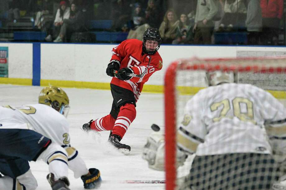 Tiernan Curley (20) of the Fairfield Prep Jesuits takes a shot on goal against Notre Dame of Fairfield Wednesday January 8, 2020 at The Rinks in Shelton, Connecticut. Photo: David G. Whitham / For Hearst Connecticut Media / Stamford Advocate Freelance