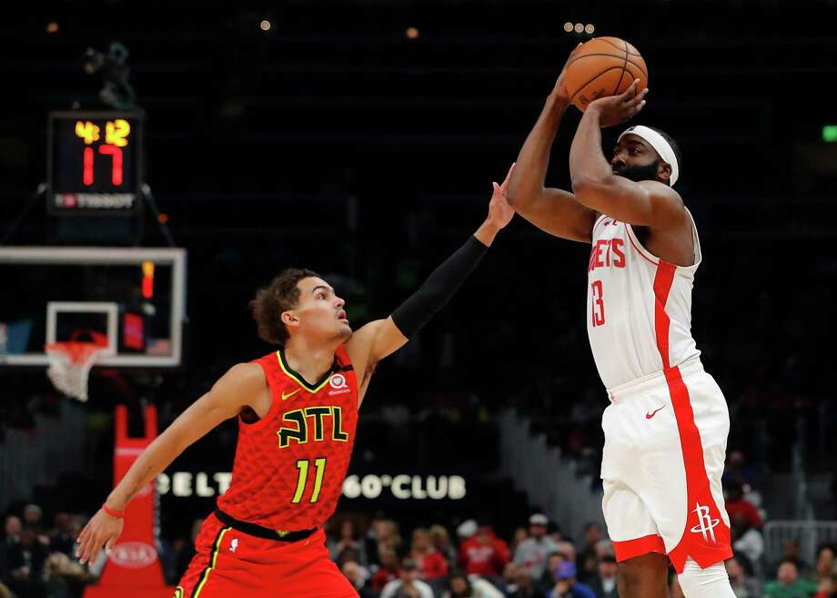 James Harden (13) of the Houston Rockets shoots a three-point basket against Trae Young (11) of the Atlanta Hawks in the first half at State Farm Arena on January 08, 2020 in Atlanta, Georgia. Photo: Kevin C. Cox, Staff / Getty Images / 2020 Getty Images