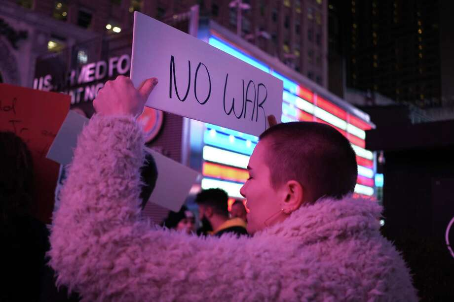 """People participate in a protest in Times Square against military conflict with Iran New York City. The """"No War With Iran"""" protest follows the assassination of Iranian general Qasem Soleimani by the Trump administration. Around the country groups are speaking out against further military actions between the two adversaries. Iran launched a series of missiles at Iraqi bases housing U.S. troops. Photo: Spencer Platt / Getty Images / 2020 Getty Images"""