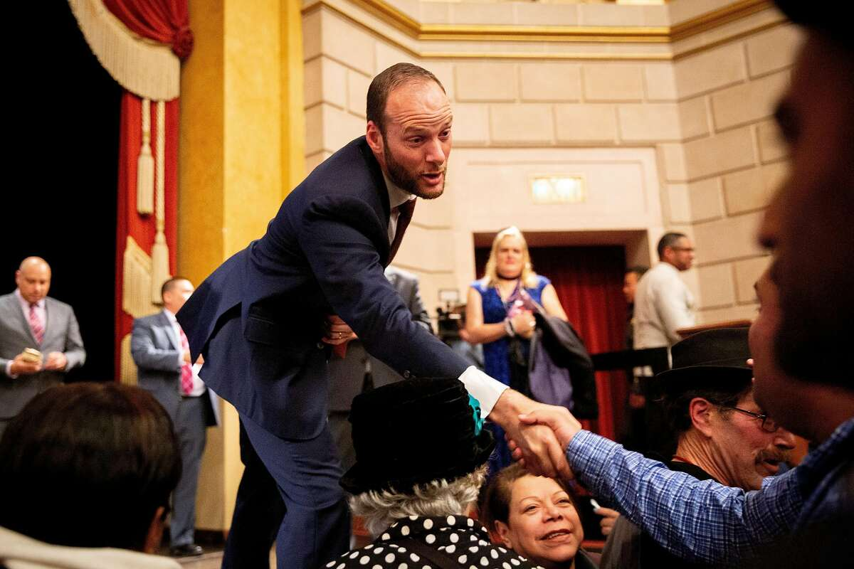 Chesa Boudin greets people after he was inaugurated as San Francisco's district attorney, Wednesday, Jan. 8, 2020, in San Francisco, Calif. Boudin's inauguration was held at Herbst Theater.