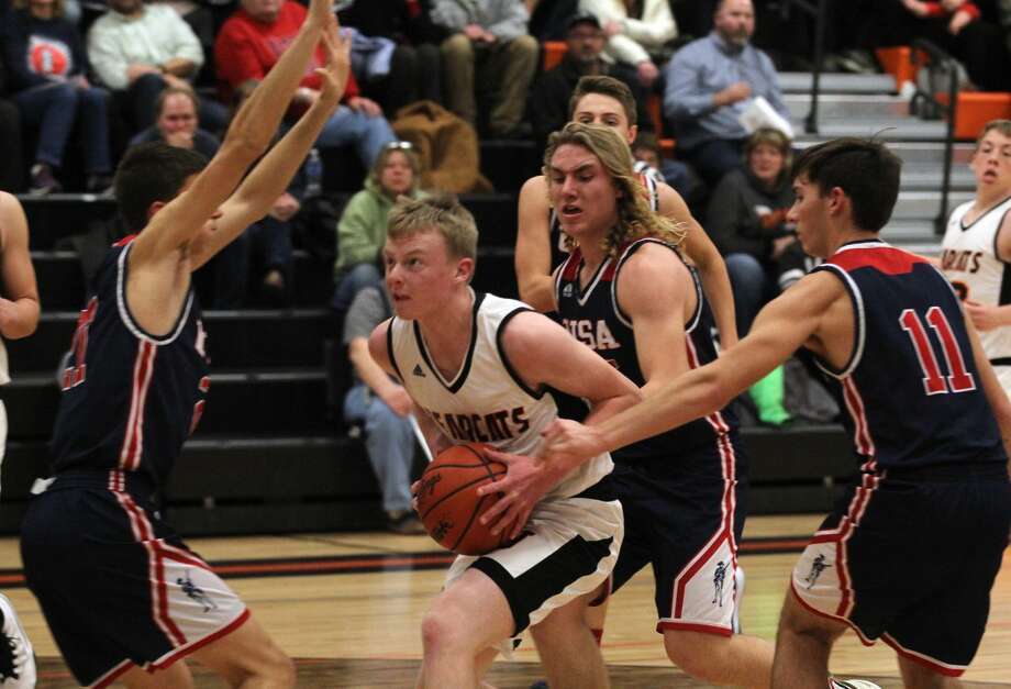 After a layoff during the holiday break, the USA boys basketball team was back to business against Ubly and posted a decisive 57-41 victory on the road against the Bearcats Wednesday night. Photo: Mark Birdsall/Huron Daily Tribune