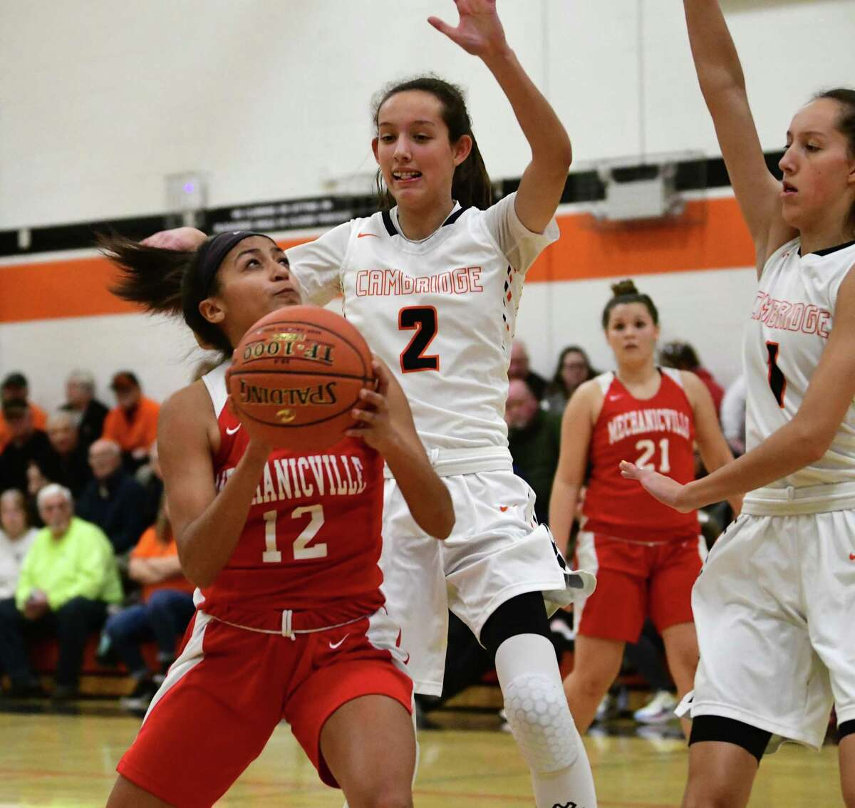 Mechanicville's Jada Brown drives to the basket against Cambridge's Sophie Phillips, #2, and Lilly Phillips during a game on Wednesday, Jan. 8, 2020 in Cambridge, N.Y. (Lori Van Buren/Times Union)