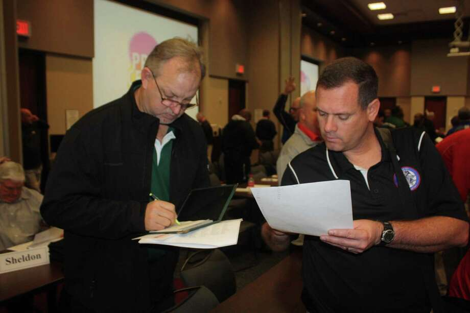 Former Pasadena ISD Athletic Director Rodney Chant (right) and former Pasadena head football coach Jeff Ganske look over a UIL's past realignment announcement. The Pasadena ISD schools are 26 days away from learning their newest biennial realignment fate. Photo: Robert Avery