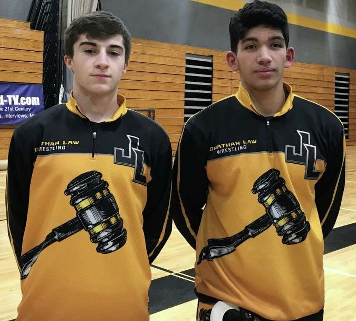 Jonathan Law co-captain's Alex DeLorio and Antonio Rosado posted wins in the match with Shelton.