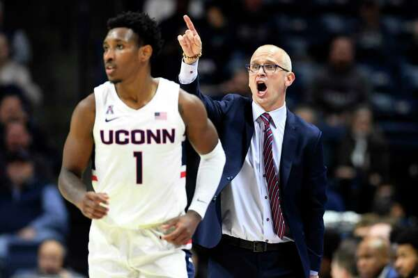 UConn coach Dan Hurley yells instructions to his team including Christian Vital (1) in the first half of a game against Tulane Wednesday, Jan. 8 in Storrs.
