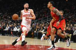 Houston Rockets guard Austin Rivers (25) drives as Atlanta Hawks forward John Collins during the second half of an NBA basketball game Wednesday, Jan. 8, 2020, in Atlanta. Houston won 122-115. (AP Photo/John Amis)