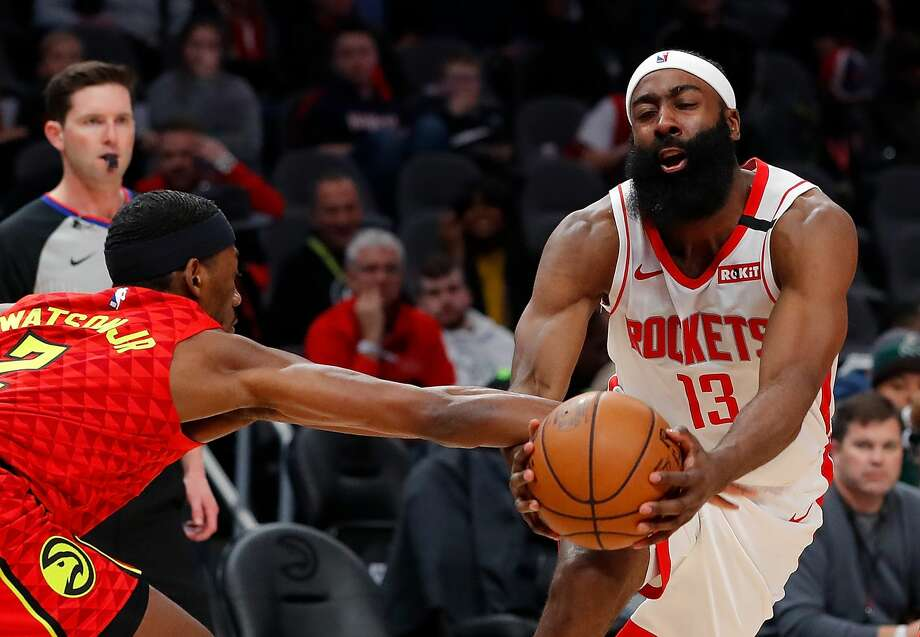 ATLANTA, GEORGIA - JANUARY 08: James Harden #13 of the Houston Rockets draws a foul as he drives against Paul Watson Jr. #2 of the Atlanta Hawks in the first half at State Farm Arena on January 08, 2020 in Atlanta, Georgia. (Photo by Kevin C. Cox/Getty Images) Photo: Kevin C. Cox/Getty Images