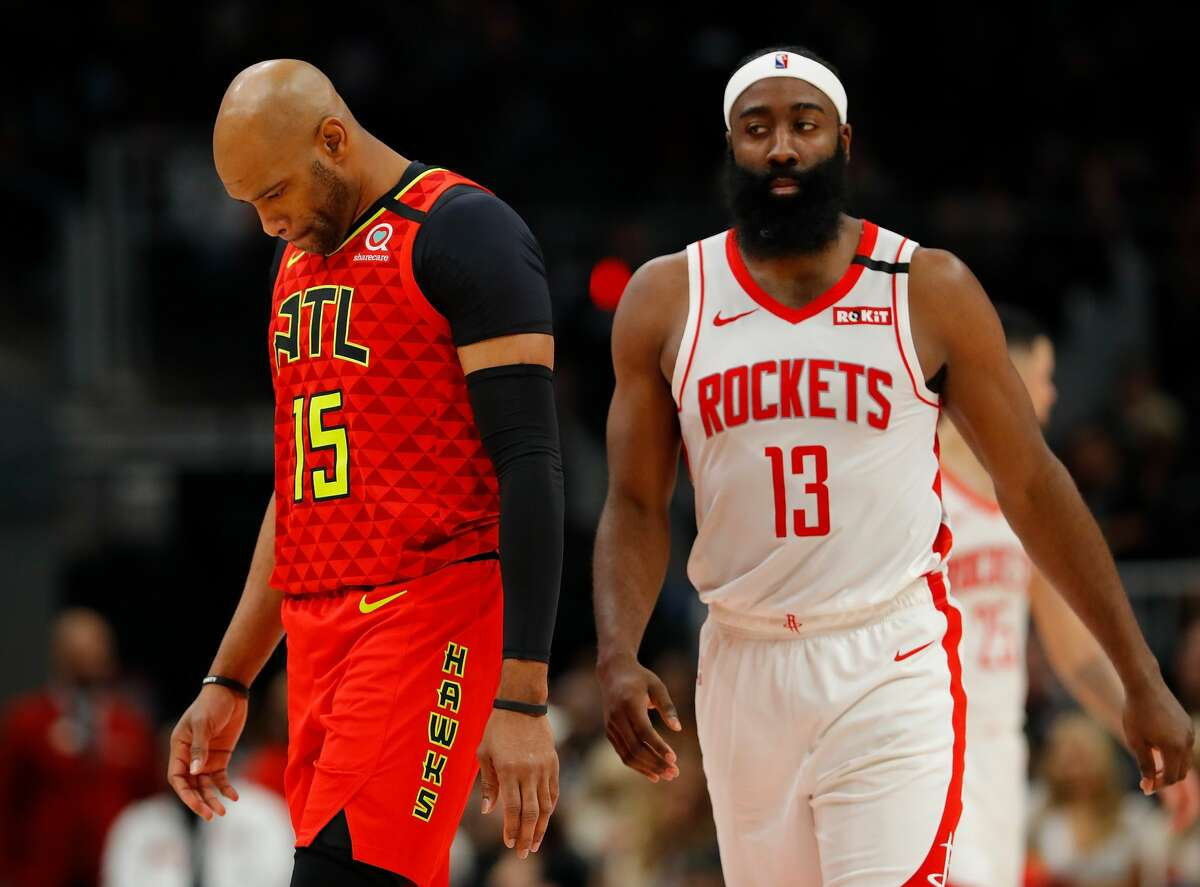 ATLANTA, GEORGIA - JANUARY 08: Vince Carter #15 of the Atlanta Hawks and James Harden #13 of the Houston Rockets walk down the court during the second half at State Farm Arena on January 08, 2020 in Atlanta, Georgia. NOTE TO USER: User expressly acknowledges and agrees that, by downloading and/or using this photograph, user is consenting to the terms and conditions of the Getty Images License Agreement. (Photo by Kevin C. Cox/Getty Images)