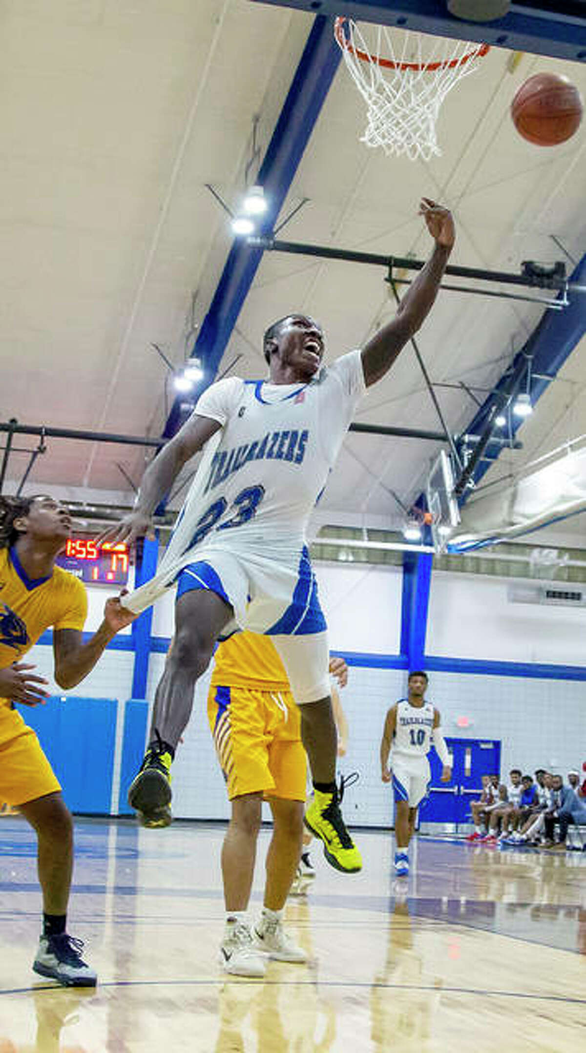 Lewis and Clark's DeAngelo Ware goes up for a shot, but is hindered by Southeastern Illinois College's MyQuion Garrett, who has a handful of Ware's jersey in Wednesday night's game at the River Bend Arena. Ware scored 22 points in LCCC's 86-73 victory