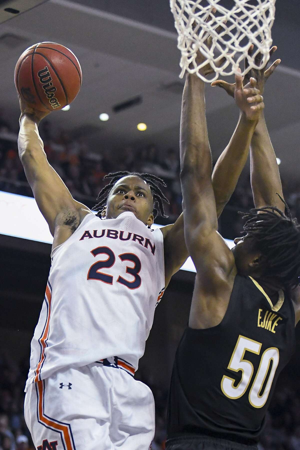 Auburn forward Isaac Okoro (23) dunks and is fouled against Vanderbilt. Okoro might aspire to play the role Andre Iguodala once played on the Golden State Warriors.