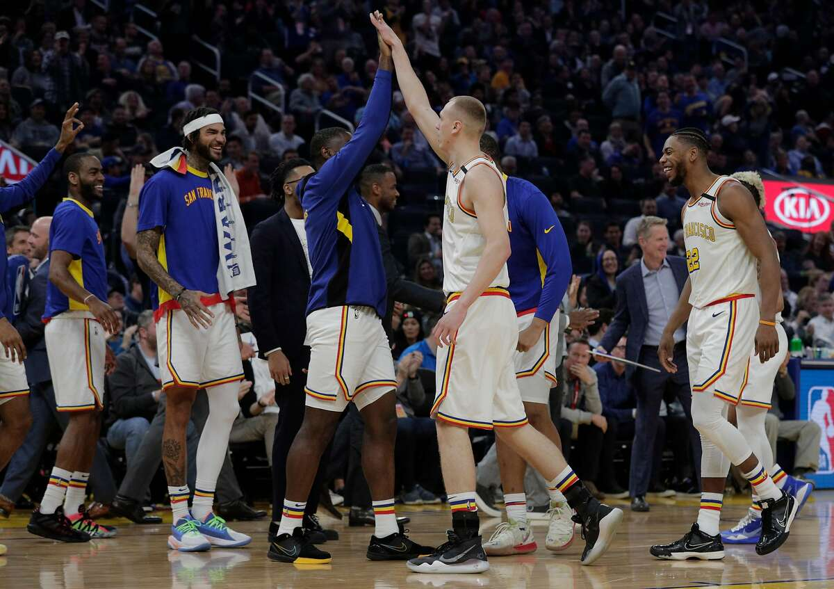 Warriors congratulate Alen Smailagic (6) after his three pointer in the first half as the Golden State Warriors played the Milwaukee Bucks at Chase Center in San Francisco, Calif., on Wednesday, January 8, 2020.
