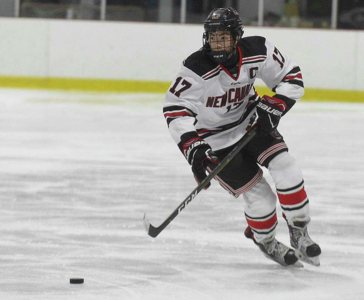 New Canaan's Justin Wietfeldt (17) skates with the puck during the Rams' win over Notre Dame-Fairfield at the Darien Ice House on Saturday.