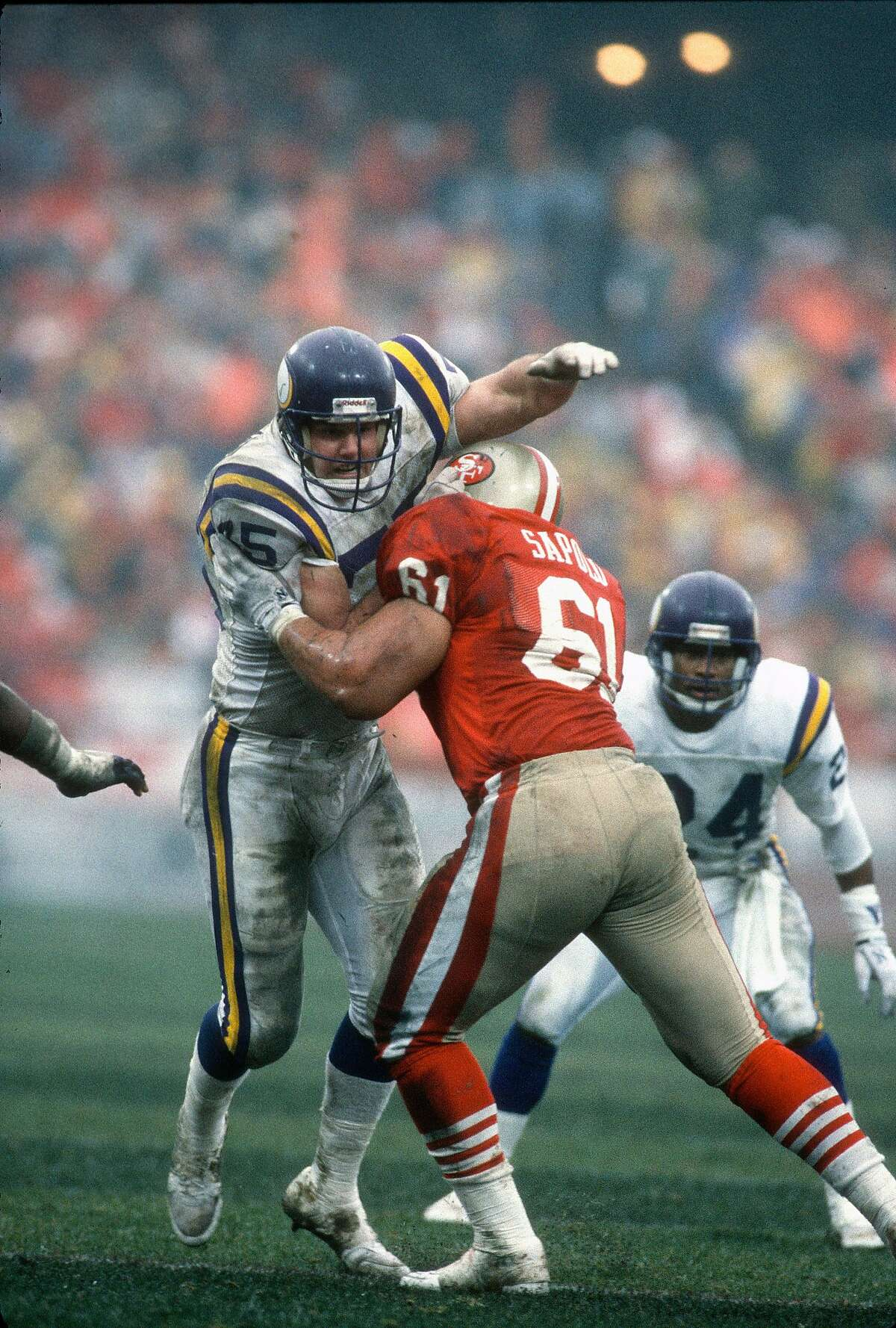 SAN FRANCISCO, CA - JANUARY 6: Keith Millard #75 of the Minnesota Viking rushes up against the block of Jesse Sapolu #61 of the San Francisco 49ers during the NFC Divisional Playoff game January 6, 1990 at Candlestick Park in San Francisco, California. M