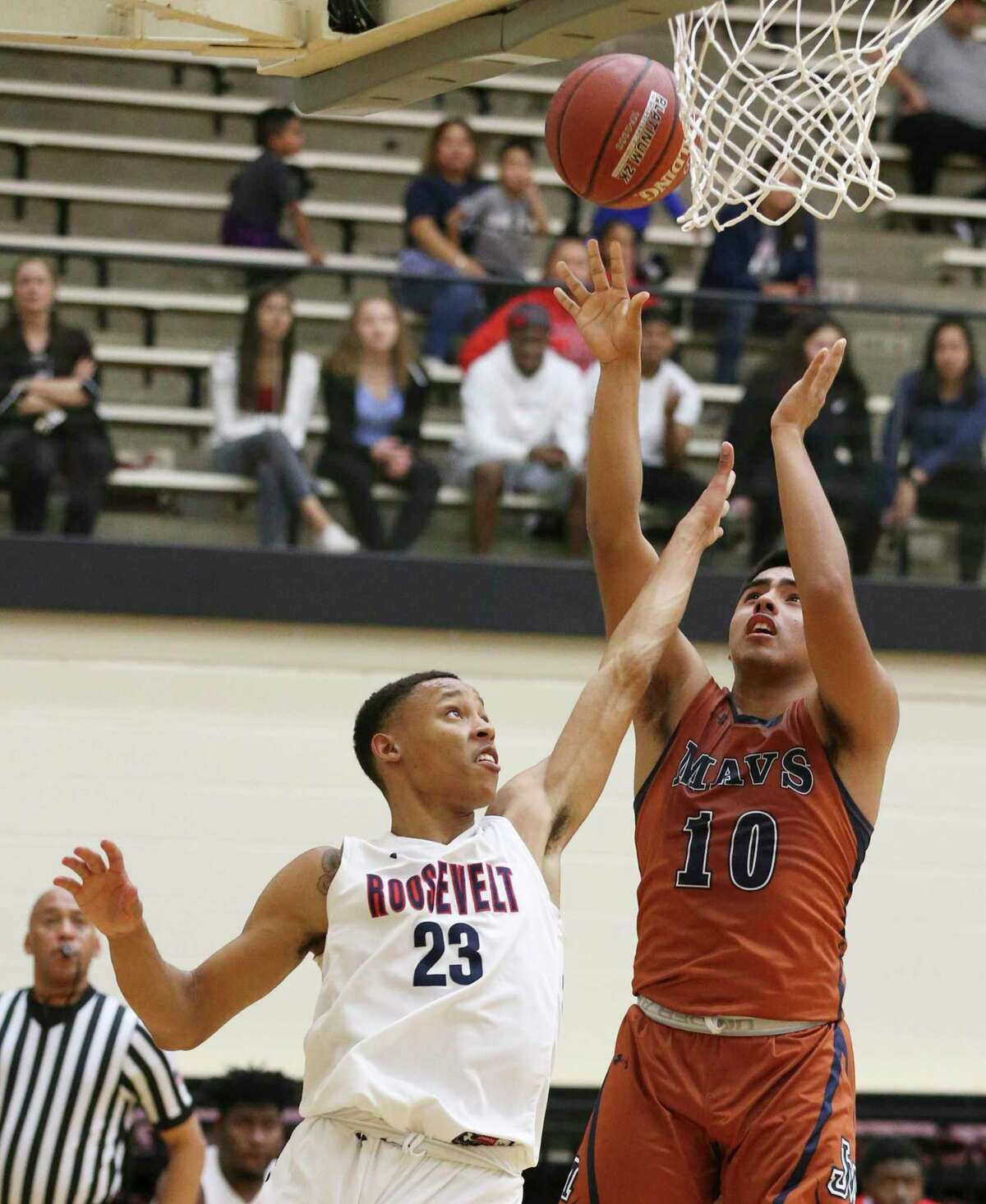 Madison's Ayden Zavala (10) puts up a shot against Roosevelt's Vincent Finch-Mann (23) during their basketball game at Littleton Gym on Wednesday, Jan. 8, 2020. The Roughriders defeated the Mavericks, 52-48.