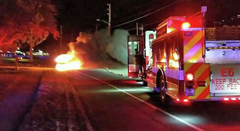Long Hill firefighters extinguished a car that had its engine compartment fully involved with fire Wednesday night on Jan. 8, 2020. It happened around 9:45 p.m in the area of the Long Hill Green on Route 111 in Trumbull. Photo: Long Hill Volunteer Fire Co.