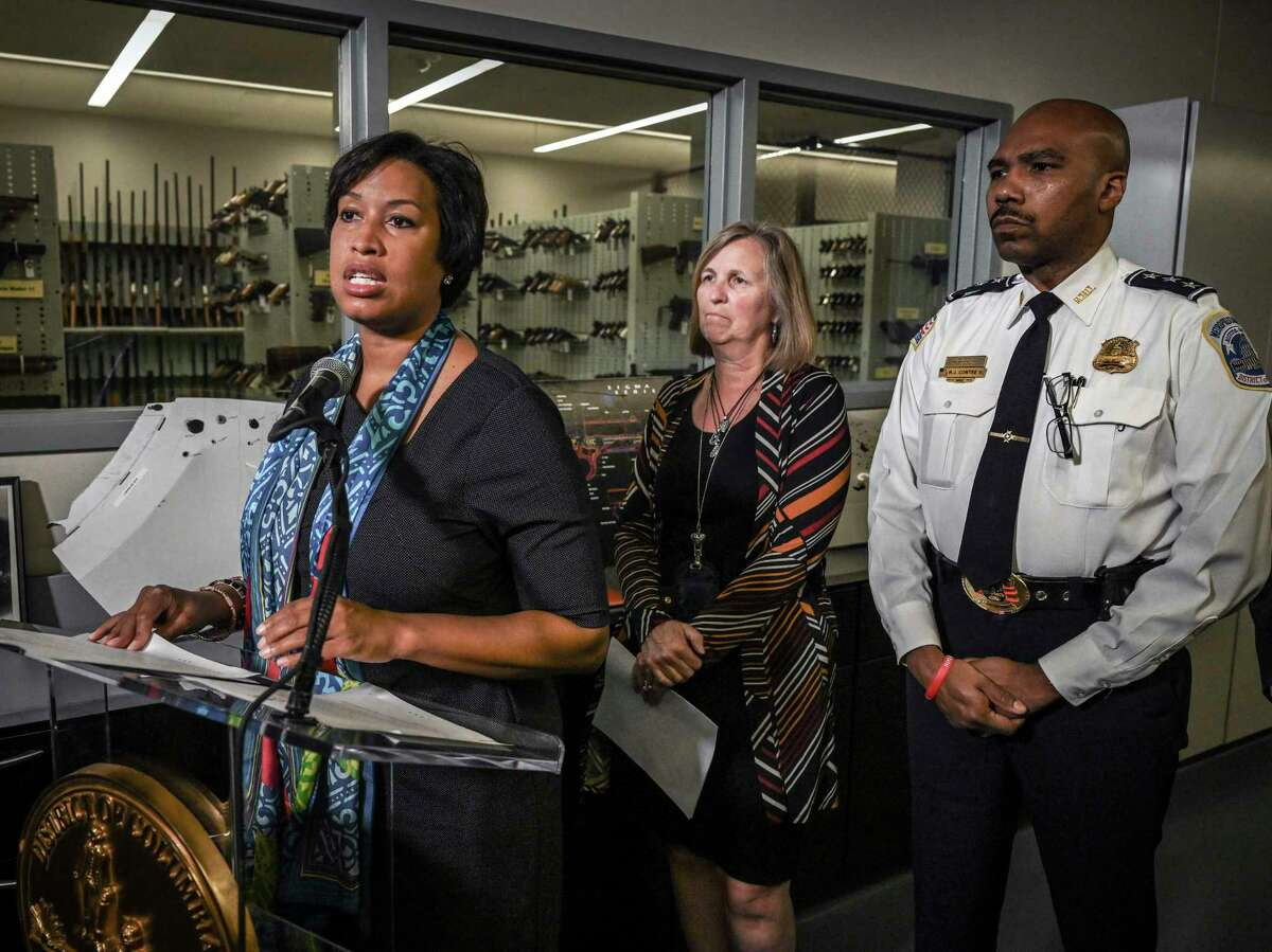 Washington, D.C., Mayor Muriel Bowser announces additional resources to support the city's Criminal Gun Information Center, with Jenifer Smith, director of the Department of Forensic Sciences and Robert Contee, assistant chief of the Metropolitan Police Department, on Sept. 24, 2019, in Washington, D.C.