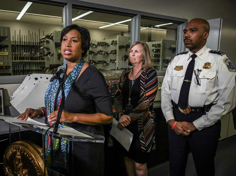 Washington, D.C., Mayor Muriel Bowser announces additional resources to support the city's Criminal Gun Information Center, with Jenifer Smith, director of the Department of Forensic Sciences and Robert Contee, assistant chief of the Metropolitan Police Department, on Sept. 24, 2019, in Washington, D.C. Photo: Washington Post Photo By Bill O'Leary / The Washington Post