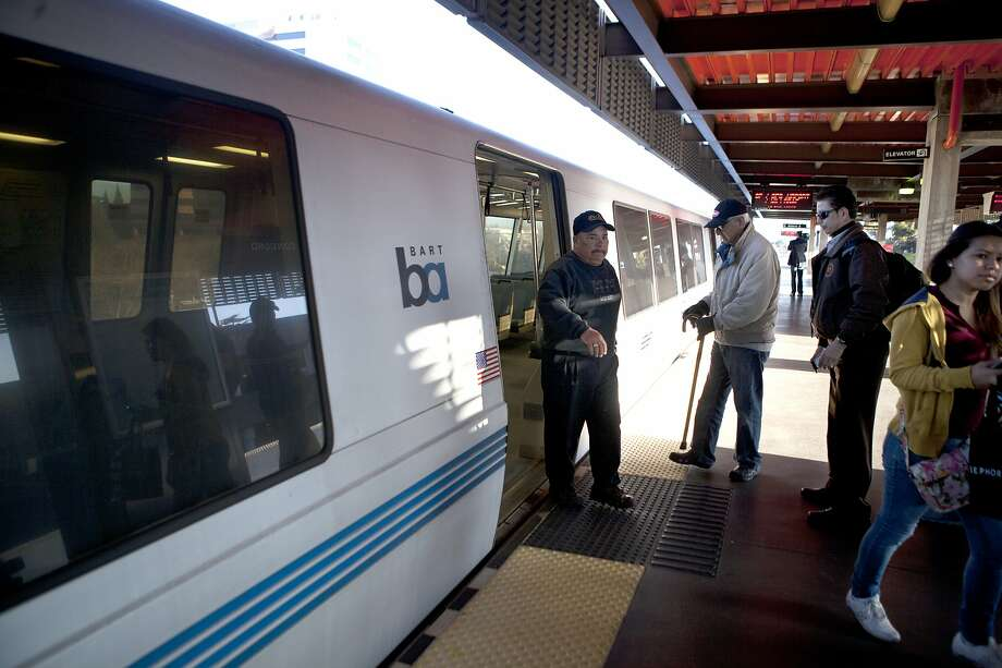 BART riders file on and off of the first BART train to stop at the Concord station following a train jumping the tracks last Friday, in Concord Calif. on Feb. 23 2014. Photo: Deborah Svoboda / The Chronicle